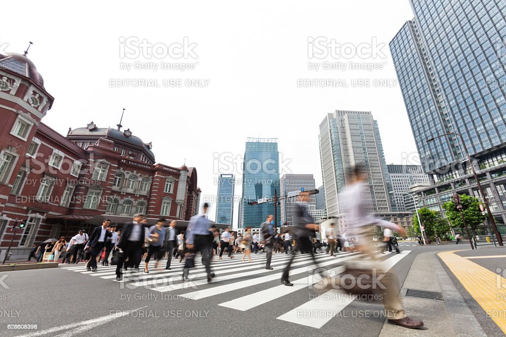 Tokyo Railroad Station Behind Busy City Commuters stock photo