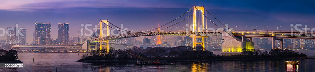 Tokyo Rainbow Bridge soaring over harbour bay futuristic cityscape Japan stock photo