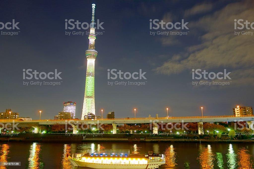 Tokyo sky tree and sightseeing boat at night stock photo