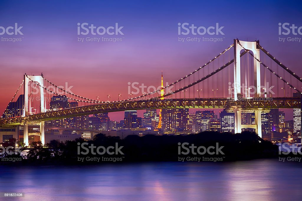 Tokyo skyline and Rainbow Bridge during dusk stock photo