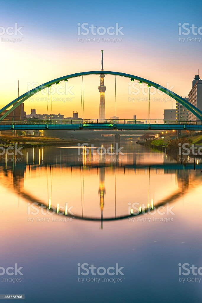 tokyo skytree and colorful bridge in refection in sumida river stock photo