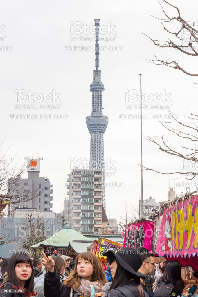 Tokyo skytree in the winter with branches foreground and with sky view from Nakamise market February 18, 2017 in Tokyo, Japan stock photo
