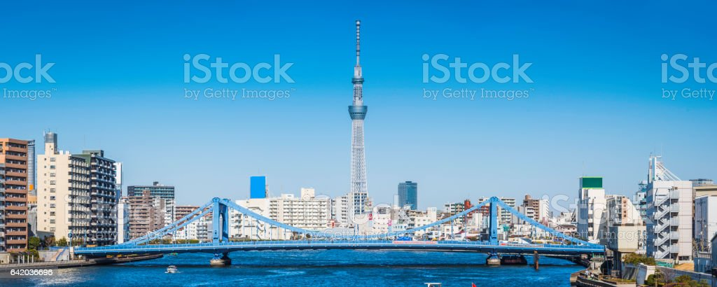 Tokyo Skytree soaring above Kiyosu bridge Sumida river cityscape Japan stock photo