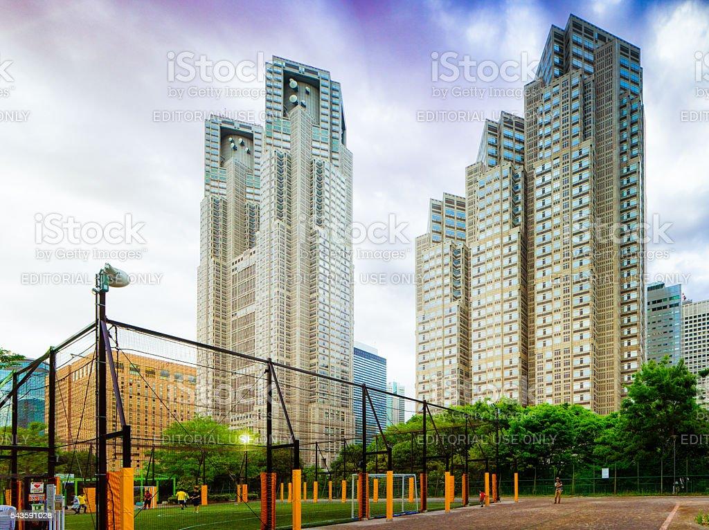 Tokyo soccer field under city hall and Shinjuku Park tower stock photo