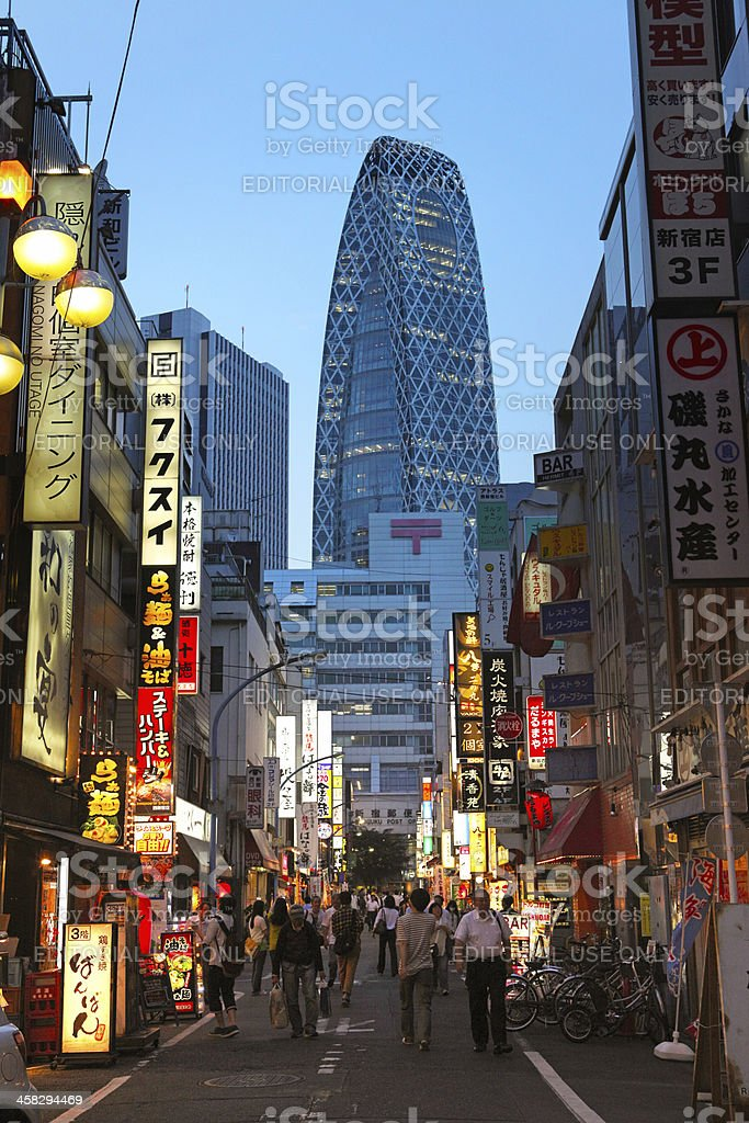 Tokyo streetlife with people walking, skycraper and colored lights royalty-free stock photo