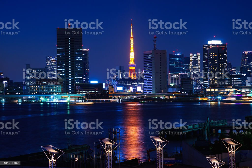 Tokyo Tower and High Rise Buildings at Night stock photo