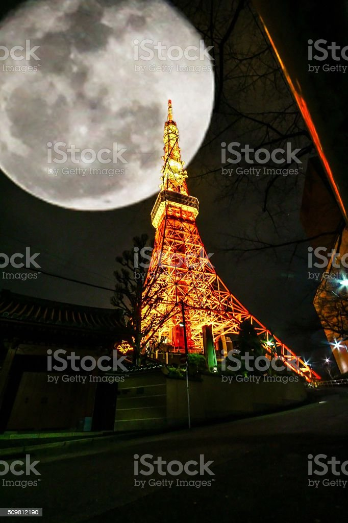 tokyo tower in full moon night stock photo