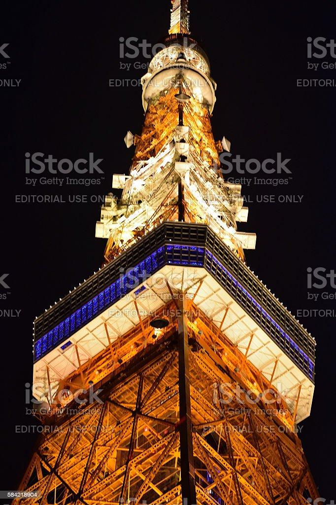 Tokyo Tower seen below and illuminated at night stock photo