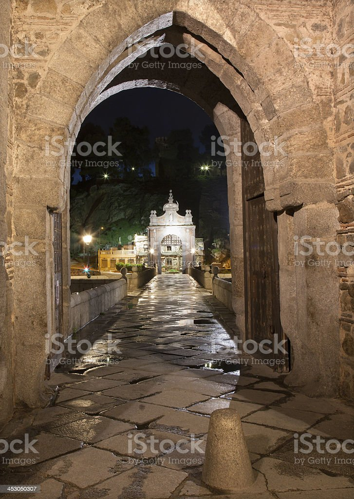 Toledo - Gothic gate of bride Puente de Alcantara stock photo