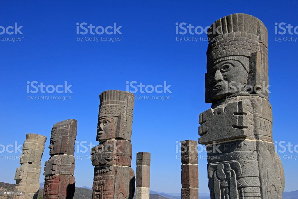 Toltec warriors columns topping the pyramid of Quetzalcoatl in Tula stock photo