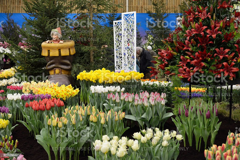 Tom Thumb with the Seven League Boots in the spring garden stock photo