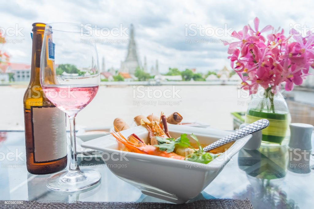 Tom yam kong or Tom yum kung, Prawn and lemon grass soup with mushrooms, Thai food, Thai Style, one of Thailand's national main dish, Close up Asian Spicy soup with shrimp in bowl. (Thai cuisine) stock photo