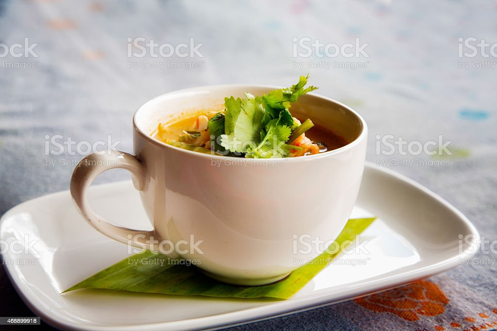 Tom Yam soup on tablecloth tilted diagonal view stock photo