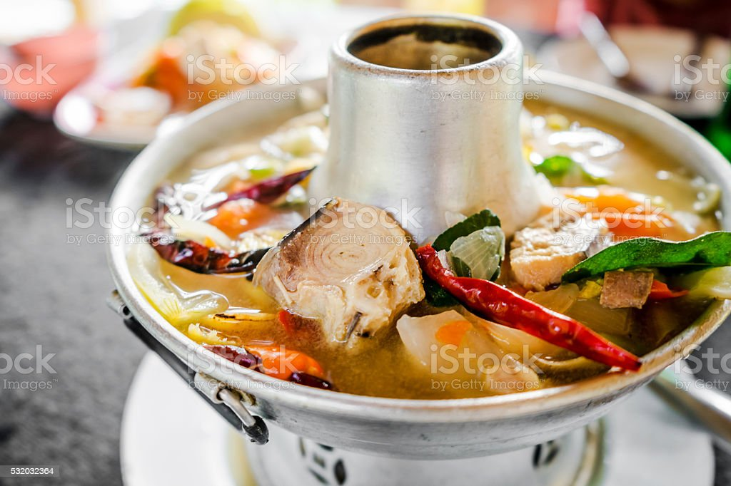 Tom Yum fish spicy soup with fresh water fish, stock photo
