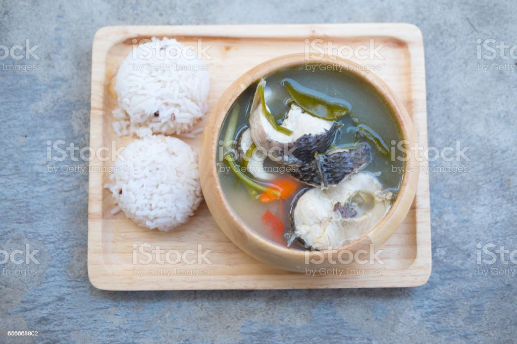 Tom Yum striped snakehead fish served with rice, Thailand style food stock photo
