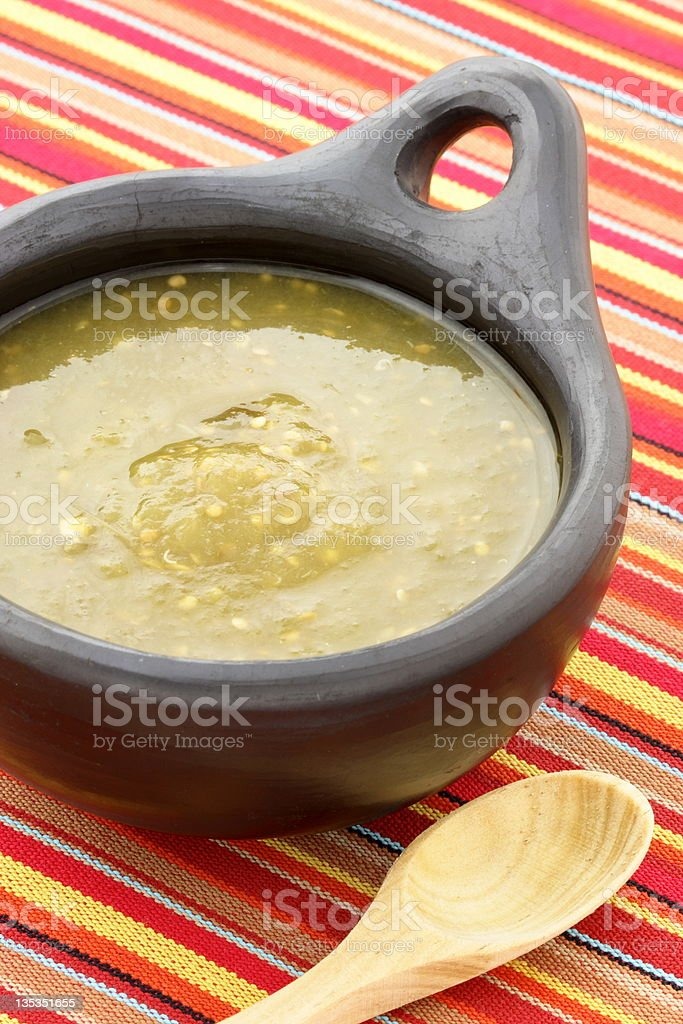 tomatillo sauce in colombian clay dish stock photo