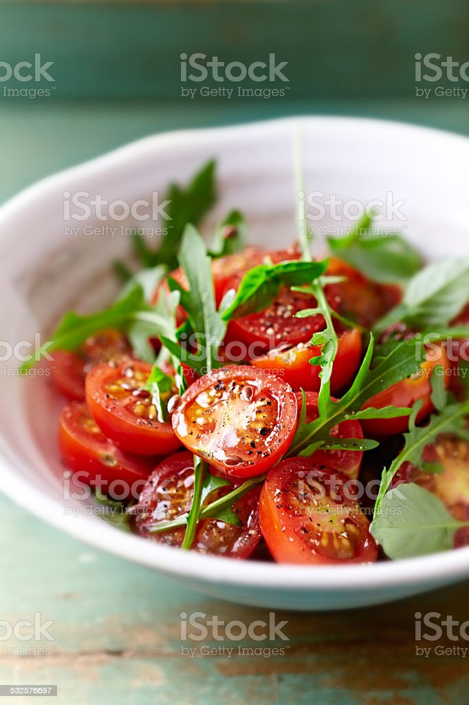 Tomato and arugula salad with flax seeds stock photo