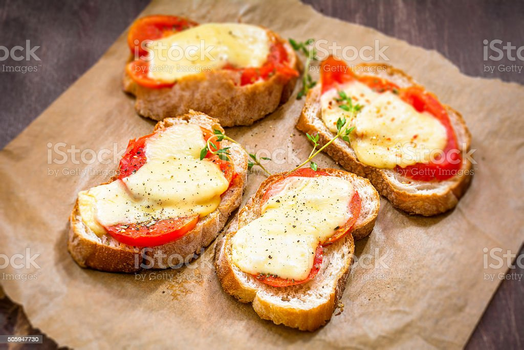 Tomato and cheese crostini stock photo