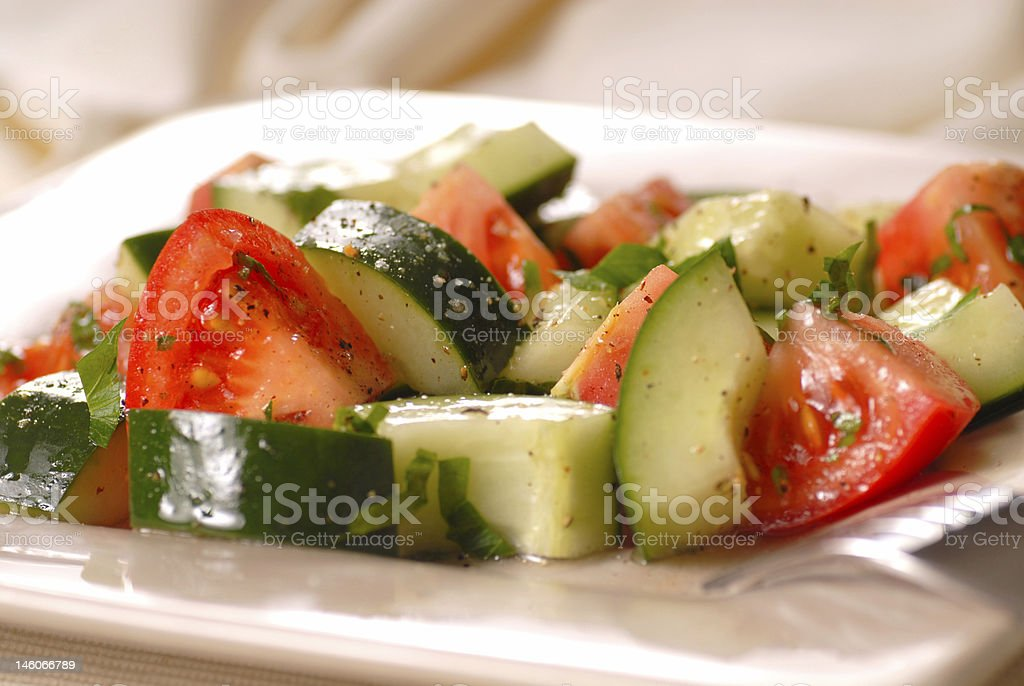 Tomato and cucumber salad with viaigrette royalty-free stock photo