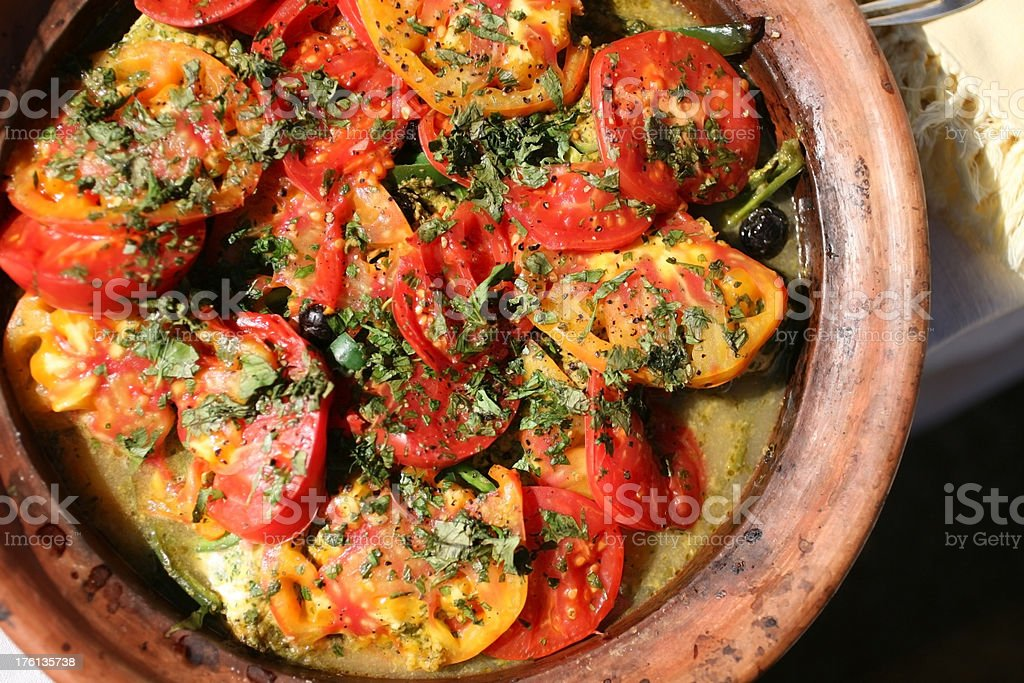 Tomato and fish stew cooked in a tagine stock photo