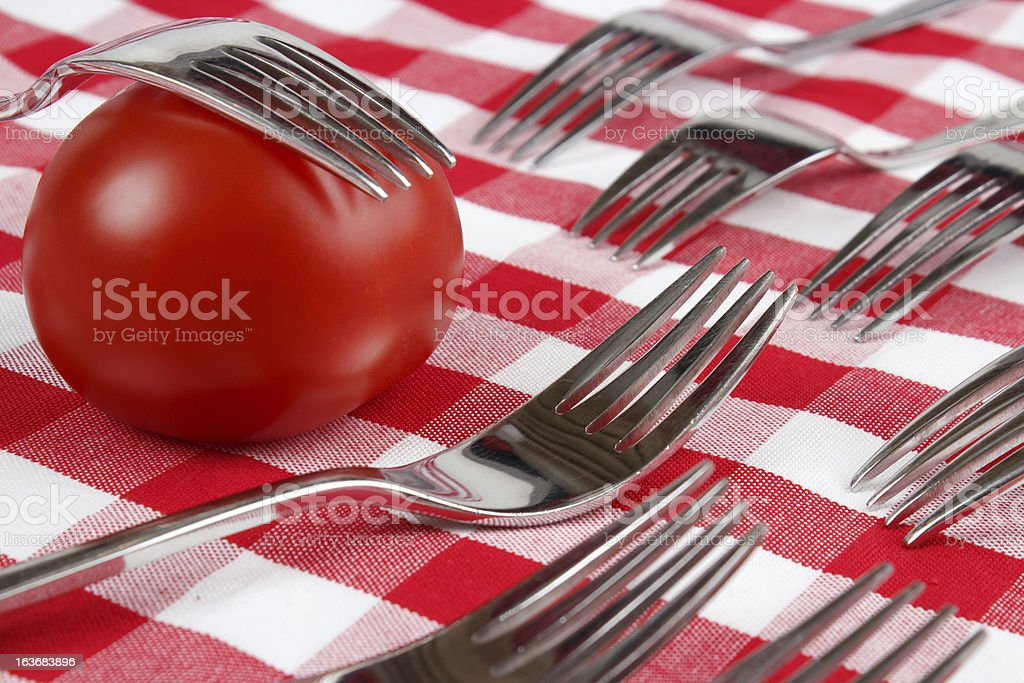 Tomato and forks royalty-free stock photo