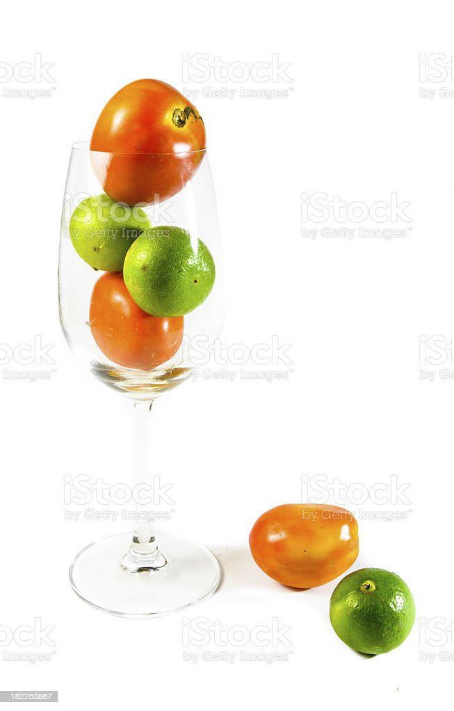 tomato and lemon in  wine glass royalty-free stock photo