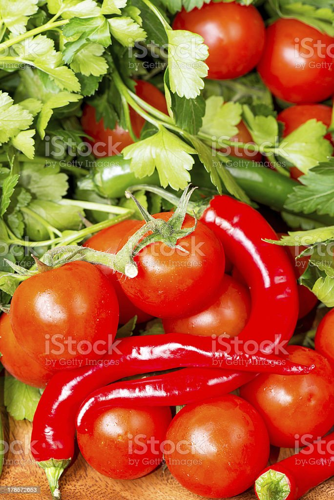 Tomato and red hot chili peppers on wooden table stock photo