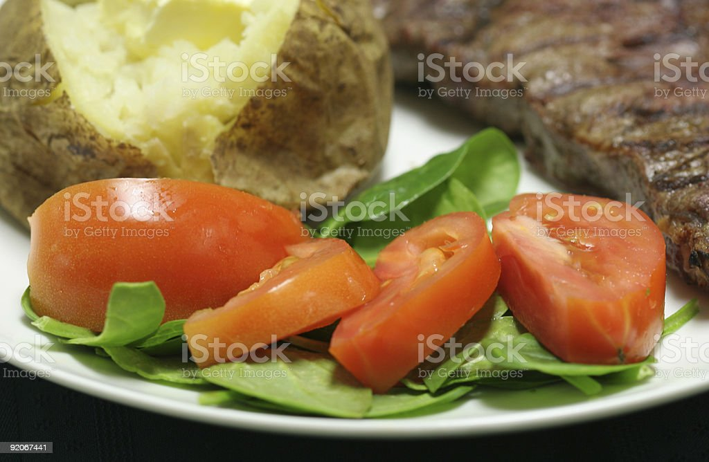 Tomato and spinach salad close up royalty-free stock photo