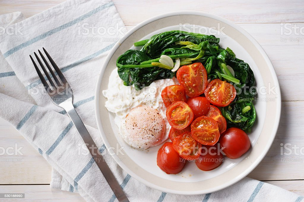 tomato and spinach salad with egg stock photo