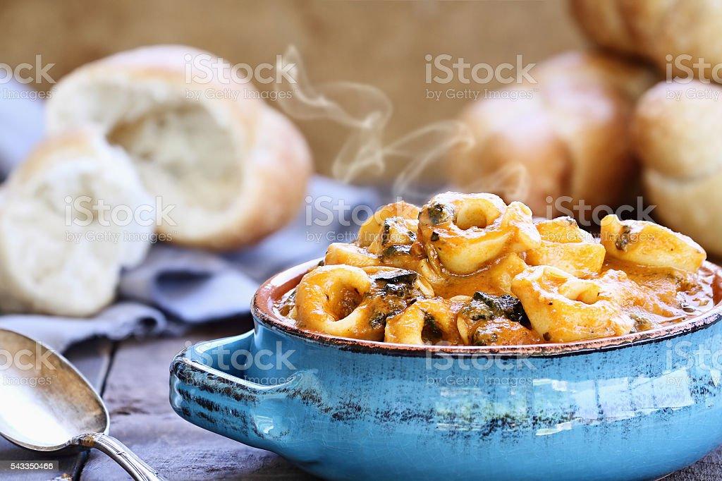 Tomato and Spinach Torellini Soup stock photo