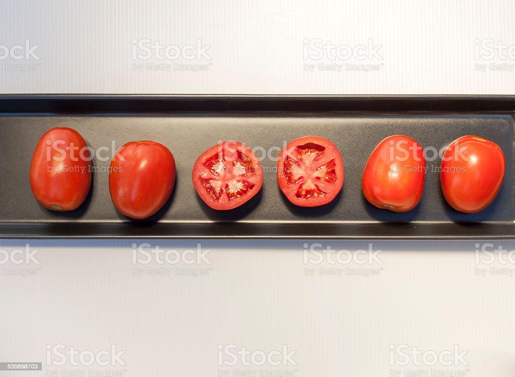 Tomato arrangement on black tray royalty-free stock photo
