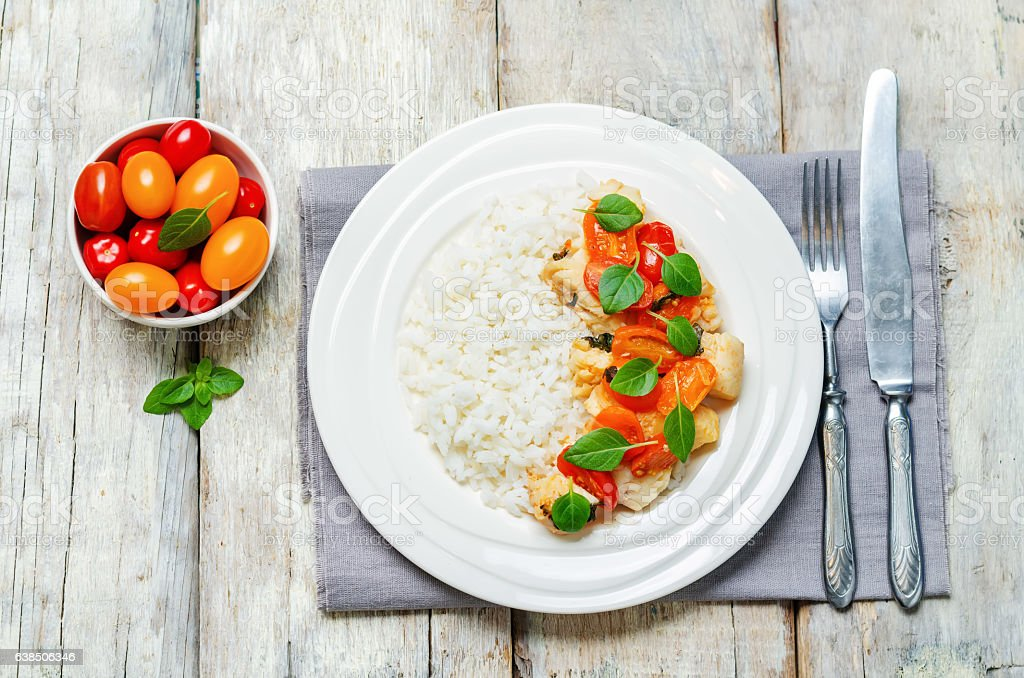 Tomato basil cod with rice stock photo