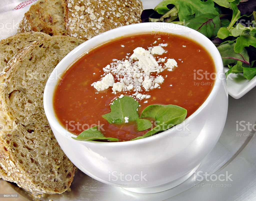 Tomato Basil Soup with Bread and Salad royalty-free stock photo