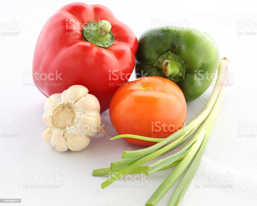 Tomato Bell Pepper Spring Onion Garlic stock photo