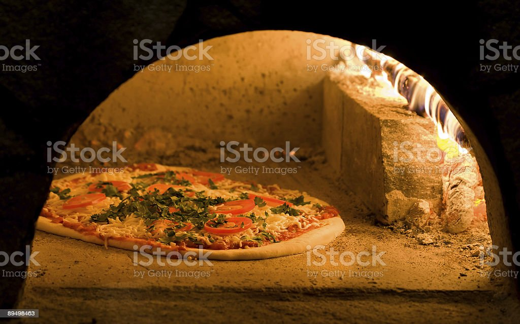 Tomato cheese and basil pizza royalty-free stock photo