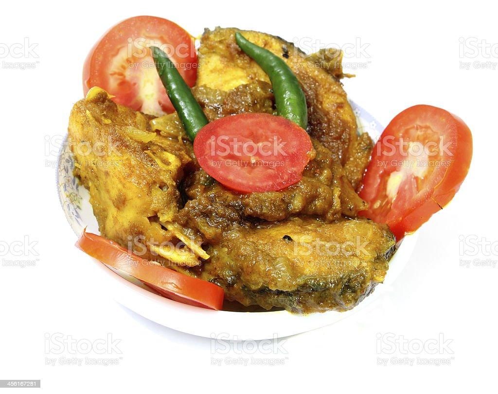Tomate chillis de poisson au curry photo libre de droits