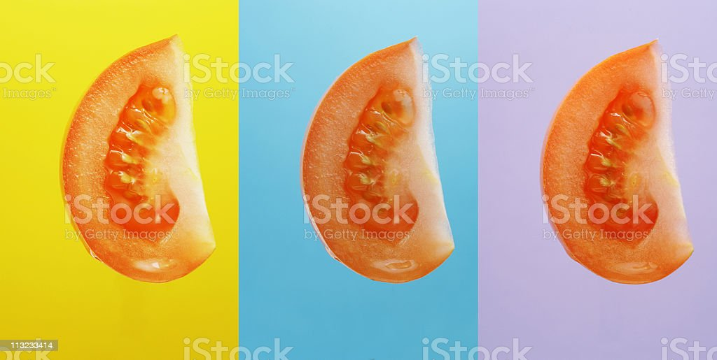 tomato chunks isolated against vibrant colors stock photo