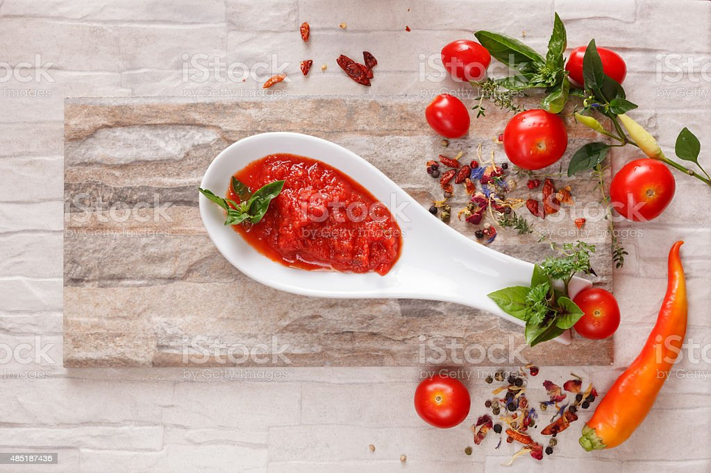 Tomato chutney with ingredients stock photo