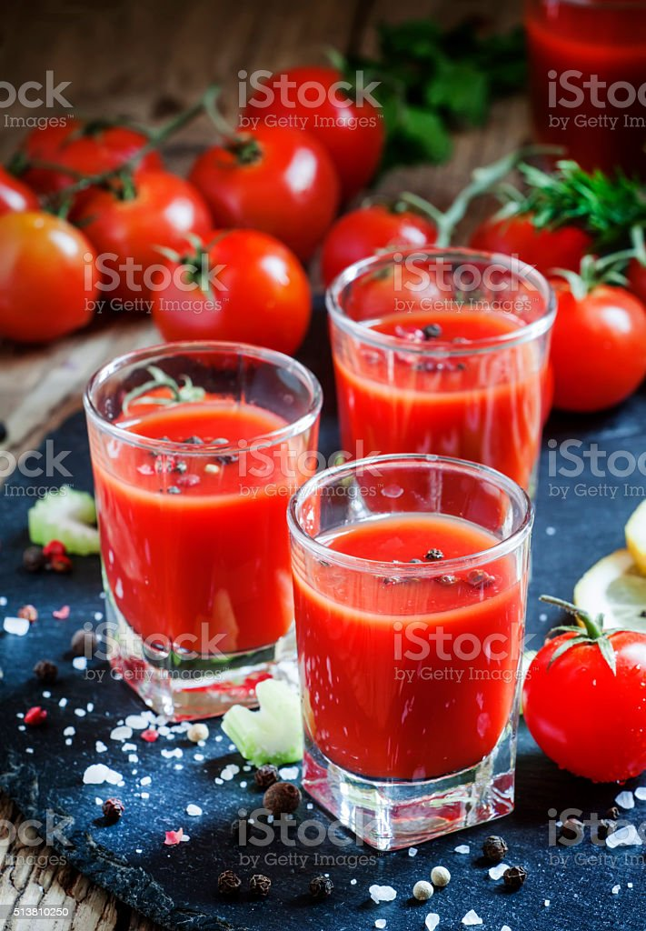 Tomato cocktail with tomatoes, lemon juice, celery stock photo