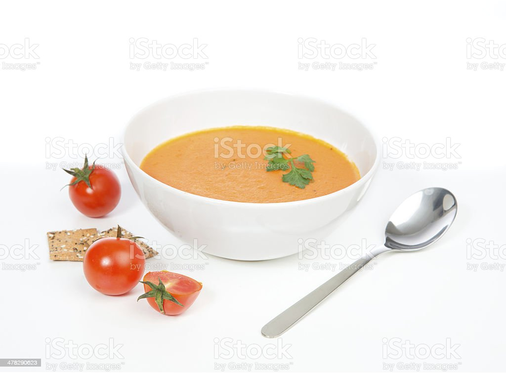 Tomato cream soup garnished with salad royalty-free stock photo