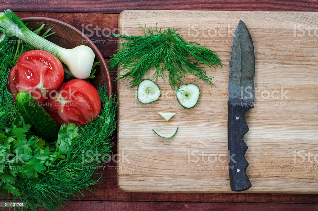 Tomato, cucumber and green herb salad stock photo