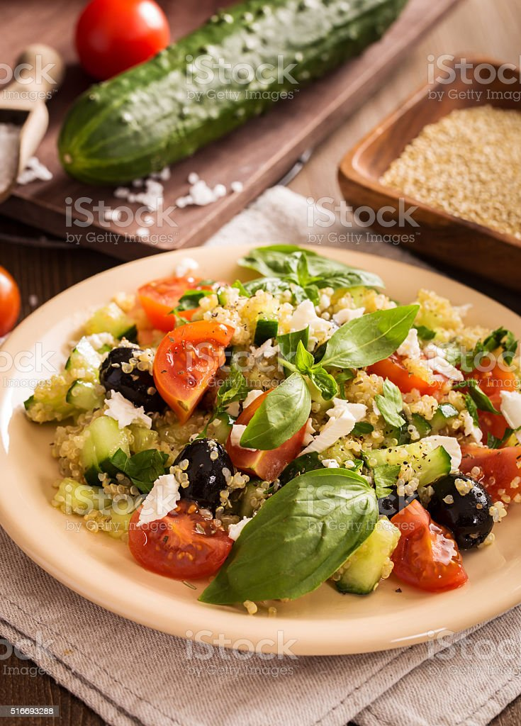 Tomato cucumber feta quinoa salad stock photo