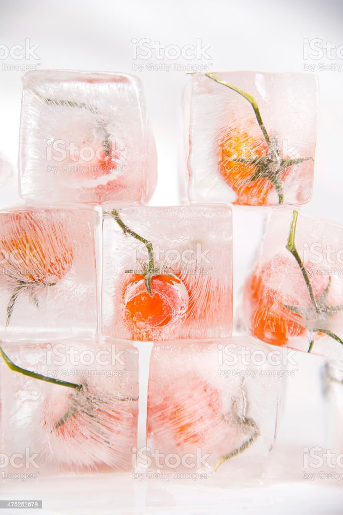 Tomato frozen stock photo