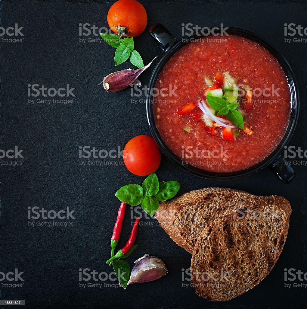 Tomato gazpacho soup with pepper and garlic stock photo