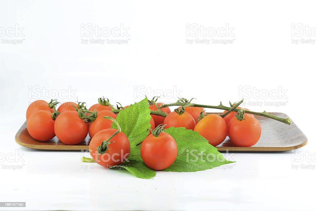 tomato in wood tray on white stock photo