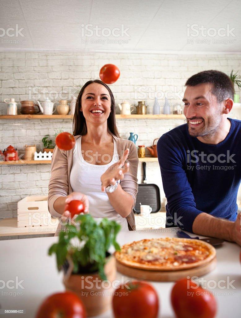 Tomato juggling stock photo