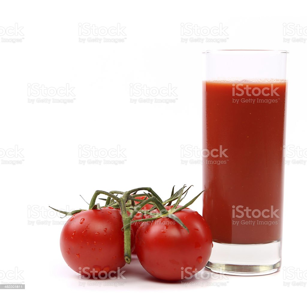 Tomato juice and cluster of small tomatoes royalty-free stock photo