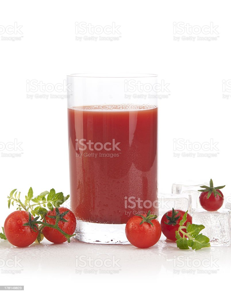 Tomato juice in a glass with tomatoes royalty-free stock photo
