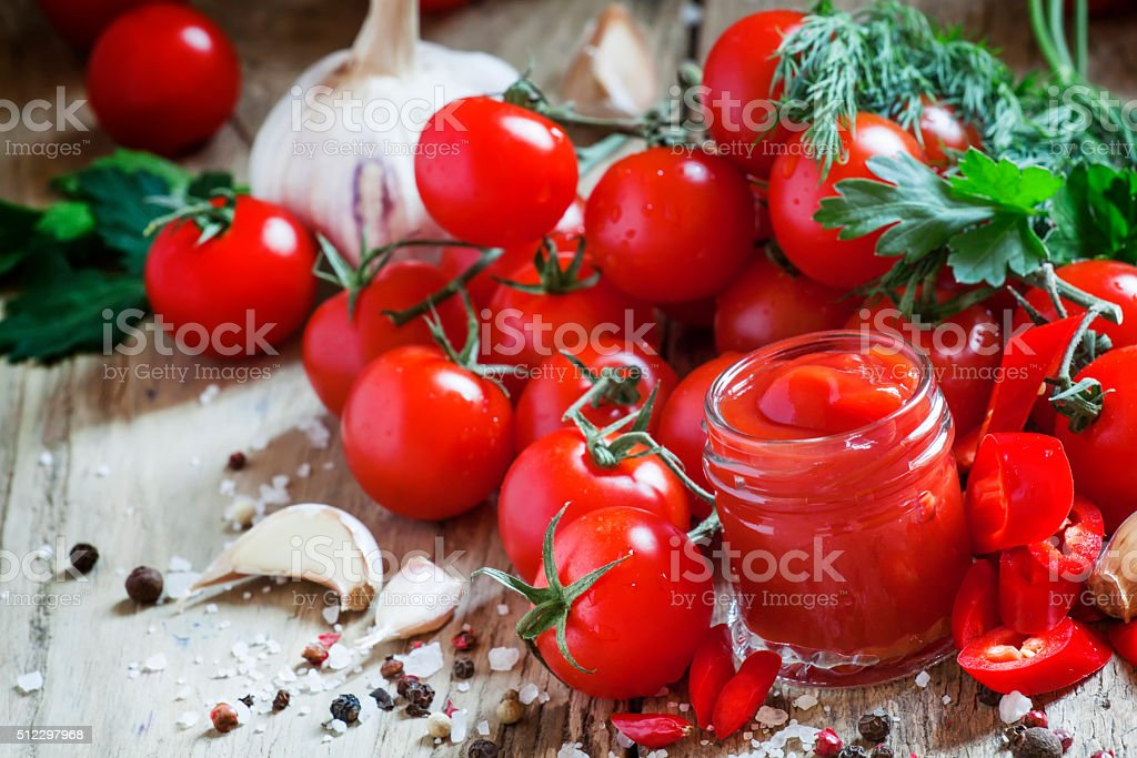 Tomato ketchup hot sauce with chili pepper stock photo