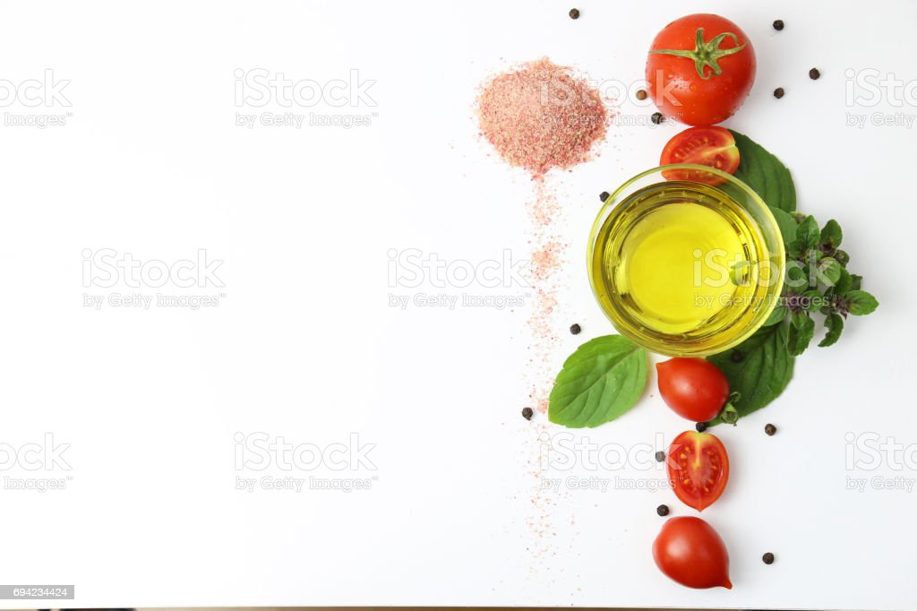 Tomato Line with Salt, Olive Oil, Basil and Black Peppercorn stock photo